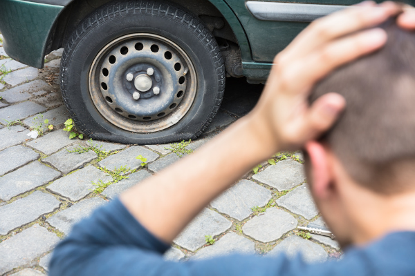 Man With Puncture Tire